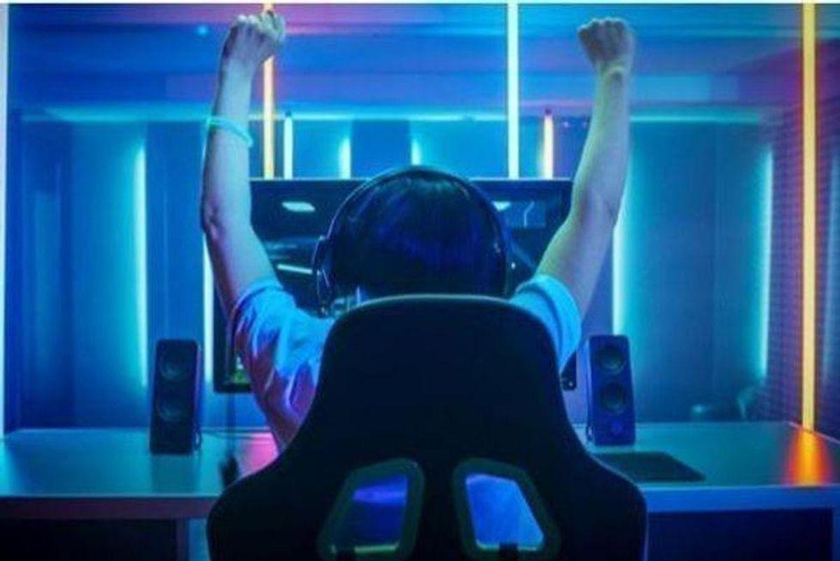 esports player raising arms