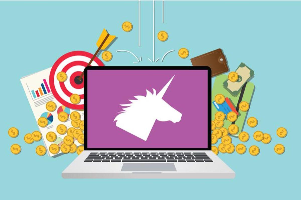laptop displaying unicorn silhouette