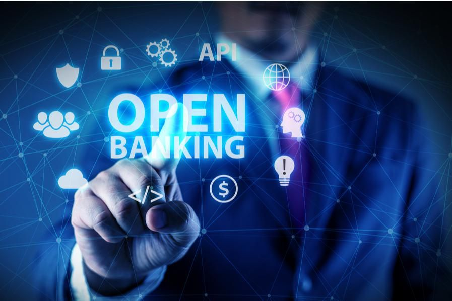 """man in suit with words """"open banking"""""""